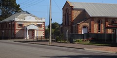 Cowell. Eyre Peninsula. The Anglican Church built in 1909 and on the other corner the Masonic Lodge also built in 1909.