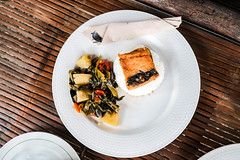 Top shot of a milkfish dish with vegetables on side