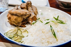 Fried chicken covered in gravy served with rice