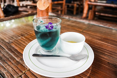 Blue colored iced mint tea with sugar syrup