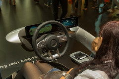 Woman tests the Mercedes Benz user experience MBUX, infotainment system for the new A-Class