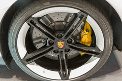 Close-up of Porsche tyres on electric sports car Taycan Turbo S