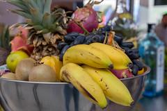 Exotic fruit basket with bananas, kiwi and pineapple