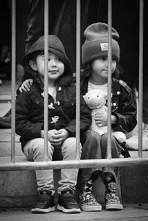 Siblings watching the parade (II)