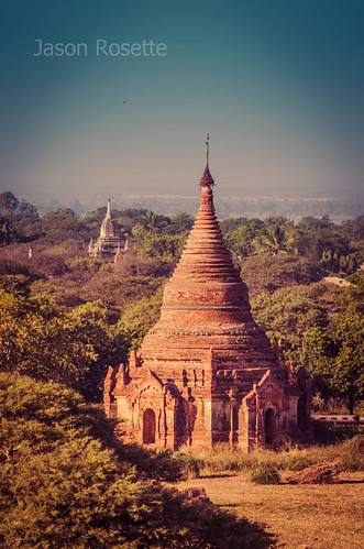 Large brick Buddhist stupa structure in Burma, with second seen beyond