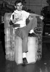 James McCamon reading the newspaper on a block of ice -Tallahassee
