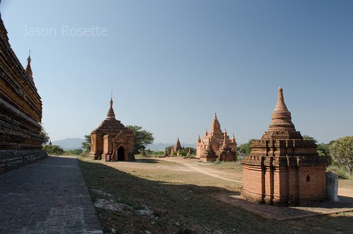 Several Sunny Temples in Burma Next to Large Temple Wall