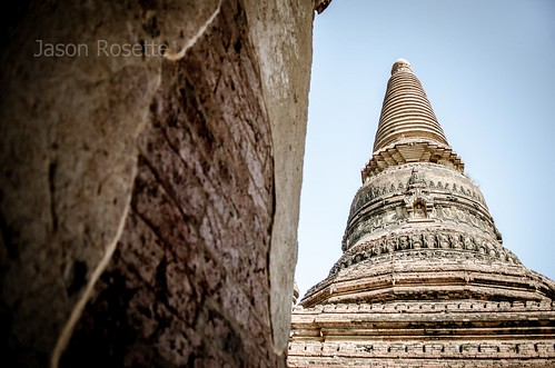 Large Buddhist Stupa Seen with Textured Stone Wall