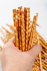 Pretzel sticks close-up in a woman's hand