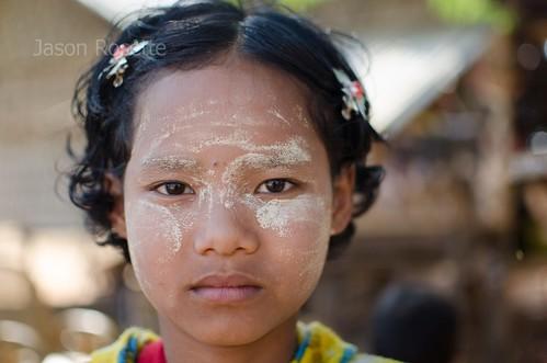 Burmese Girl with Thanaka and Yellow Pyjamas 'Serious'