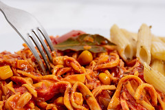 Spaghetti Bolognese on the plate with fork