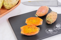 Sliced Indian Figs on the black tray with Tasty sign