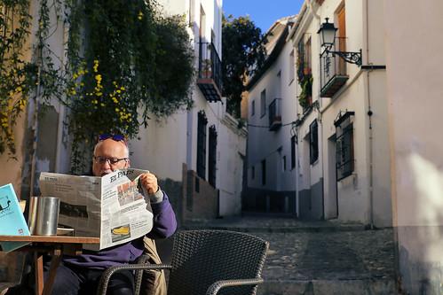 Enjoying breakfast with coffee and Spanish newspaper in Albaicín