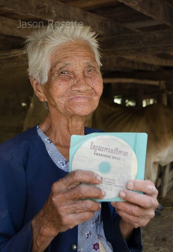Old KHmer Woman with a VCD in Rural Cambodia