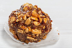 Close-up of cake with cocoa and roasted peanuts