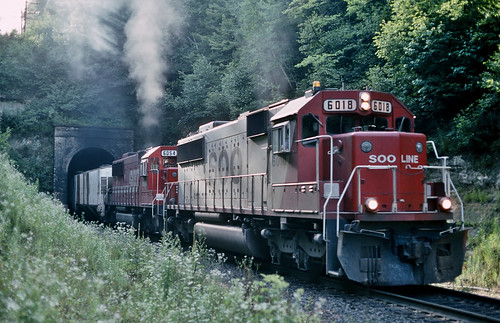 Soo Line 6018 east in Tunnel City, Wisconsin on July 19, 1992.