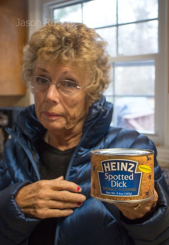 Woman poaes with a can of Spotted Dick