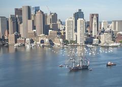 USS Constitution is tugged through Boston Harbor.