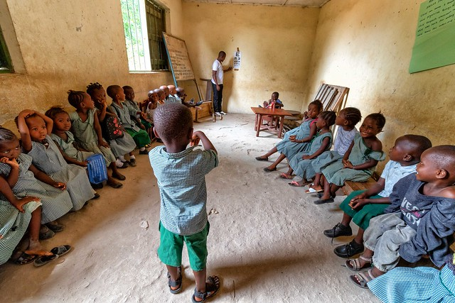 Checking the vision of a class of children in a rural government school in Sierra Leone
