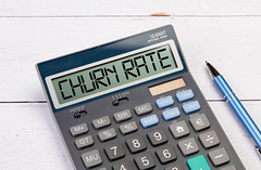 Calculator with the text Churn Rate on the display
