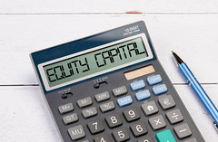 Calculator with the text Equity Capital on the display