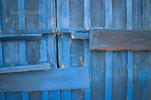 Weathered blue door and boards at train station, Cambodia