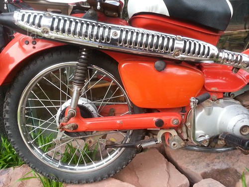 Close up Red Honda Super Cub with Knobby Tires
