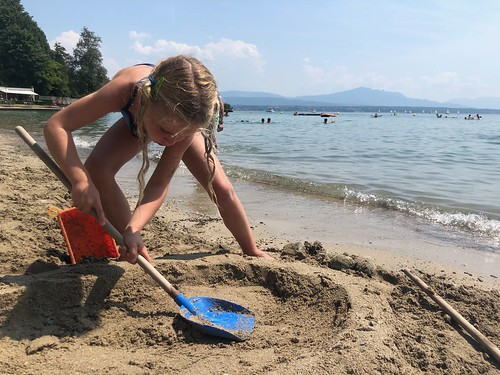 Girl digging sand on the beach
