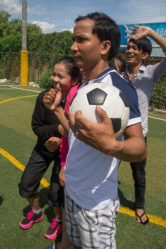 Cambodian Youths Pose for a Photo While Playing Football