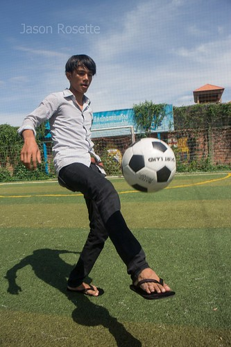 Cambodian Youth Juggles a Football