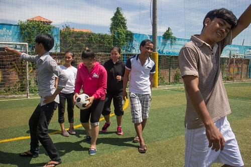 Group of Cambodian Youth Goof Off While Playing Football