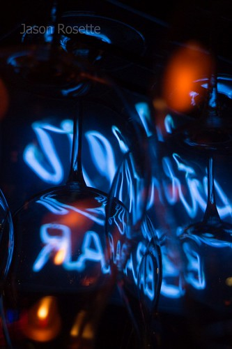 Abstract View of Blue Neon Among Hanging Glasses (vertical)