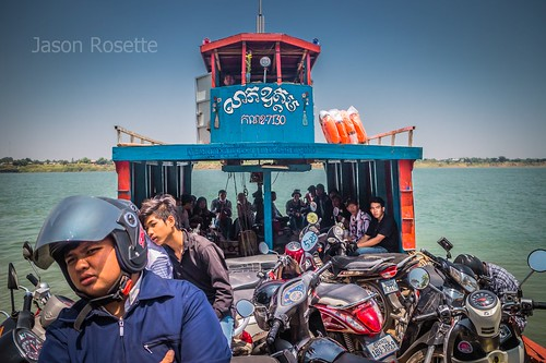 Passengers and vehicles on a Ferry Crossing the Mekong in Cambodia