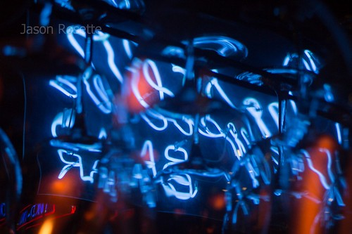 Abstract View of Blue Neon Among Hanging Glasses (#1)