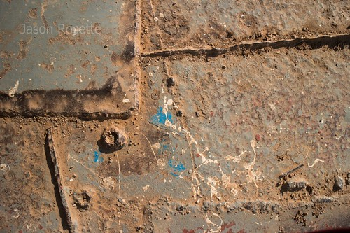 Detail of Grungy Metal Plates on Deck of Rural Ferry (#2)