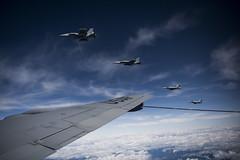 U.S. Navy EA-18G Growlers refuel from an U.S. Air Force KC-135 Stratotanker.
