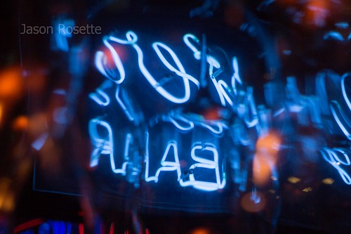 Abstract View of Blue Neon Among Hanging Glasses (#2)