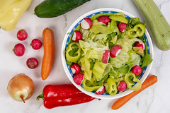 Lettuce salad with Red Radishes and Paprika and vegetables