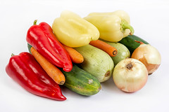 Pile of fresh vegetables on the white background