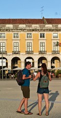 Tourist Couple trying to understand how to achieve their next step