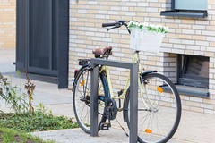 Bicycle with flower decoration parked at a residential area