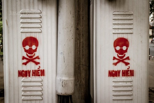 Red Warning Skulls on Electrical Box in Ho Chi Minh City