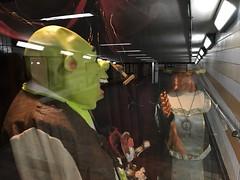 Shrek reflecting in Charing Cross station