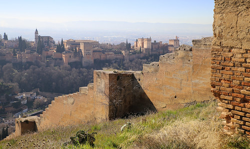 The 14th century wall leads to Alhambra