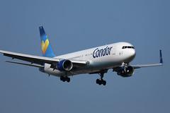 Condor plane approaching to landing, blue sky