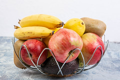 Basket with healthy fruits concept