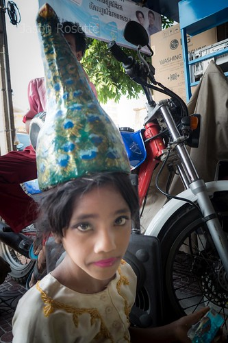 Cambodian Girl Wears a Swan Mask on Her Head