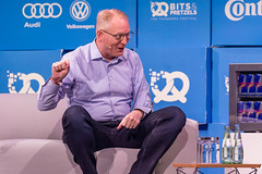 Amazon's Dave Limp interacts with the interviewer on the stage of the start-up and innovation event Bits & Pretzels in Munich