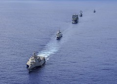 The littoral combat ship USS Gabrielle Giffords (LCS 10) leads a formation followed by the Republic of Singapore Navy (RSN) frigate RSS Formidable (FFS 68), the dry cargo ship USNS Amelia Earhart (T-AKE 6), the guided-missile destroyer USS Momsen (DDG 92)