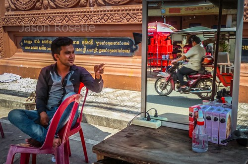 Barber with Tuk Tuk in Mirror, Phnom Penh Cambodia